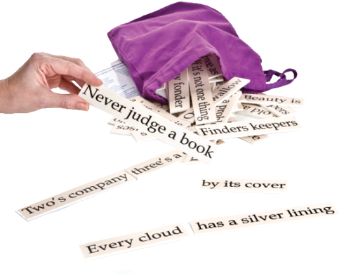 Match the Sayings Set 2, image shows purple cotton bag with drawstring opening with tiles spilling out, hand holding a tile 'Never judge a book' Set includes: 30 sayings to match on durable plastic with large print lettering. Answer card. Drawstring storage bag.  Size: Tiles: (l) various x (w) 3cm x (h) 0.3cm. Bag: (l) 33cm x (w) 24cm.