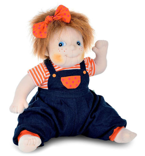 Empathy Doll Anna, soft bodied doll for dementia therapy, image shows soft doll with blue eyes and smile, auburn hair with orange bow, striped orange/white tee shirt and navy/orange dungarees in sitting position, Size: (l) 50cm. Weight: 1kg. Machine washable (30ºC and can be tumble dried on a low temperature). Clothes are removable and can be hand washed.