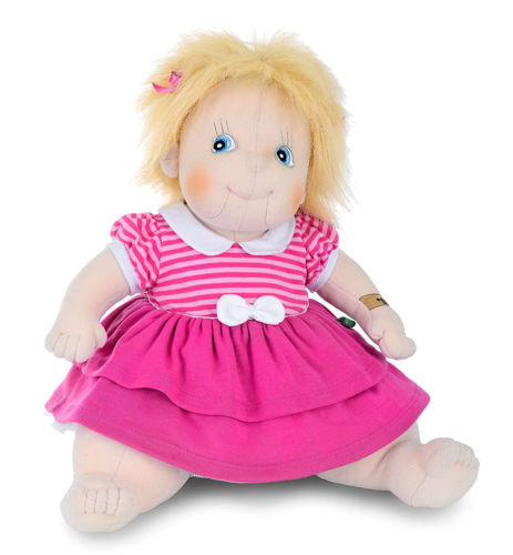Empathy Doll - Ida, soft bodied doll for dementia with blonde mid length hair and pale skin, wearing pink and white dress and has pink bow in hair, Clothes are removable and can be machine washed at 30ºC. Doll can be sponge cleaned.  Size: (l) 50cm. Weight: 1kg.