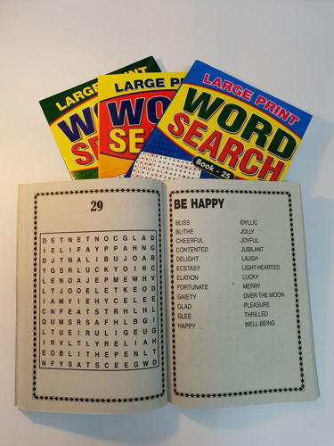 "<img src = "" Large Print Word Search Book, set of four assorted, open softback book with white pages and bold black lettering and three other closed books behind, A5 size each, colourful outer covers"">"