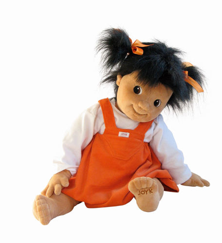 Joyk Empathy Doll - Emelie, dementia therapy doll, soft fabric body with sculptured nose and mouth, black mid length hair tied in bunches with orange ribbon, removable orange dress with white top, hand wash 40 oC, size: 65cm