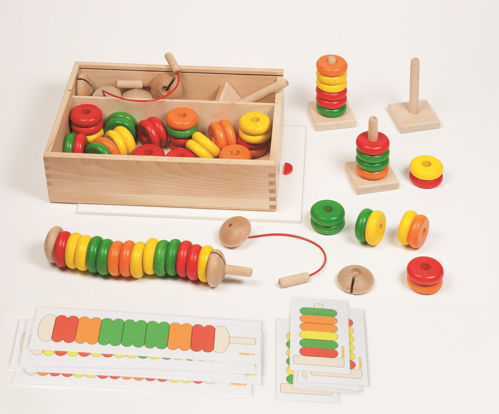 Caterpillars and Towers Thread Activity, 4 x natural wood 'caterpillar' threads,  4 x natural wooden towers, 36 x wooden beads in red, green, orange and yellow, 8 x template cards (double-sided), instructions and storage box with sliding clear lid. Size: caterpillars: (l) 28cm, tower: (h) 11.5cm, beads: (dia) 5cm x (h) 3cm, storage box: (l) 33cm x (w) 23cm x (d) 8.5cm.