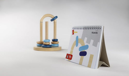 Ring Stacking With A Twist Activity, sorting game, wooden construction, consists of natural wood sorting station with twisting arch and 3 posts, 9 assorted coloured and sized flat beads, pattern display cards and instructions, size: sorting station (dia) (dia) 14cm x (h) 17.5cm, large rings (dia) 5cm, small rings (dia) 3.3cm