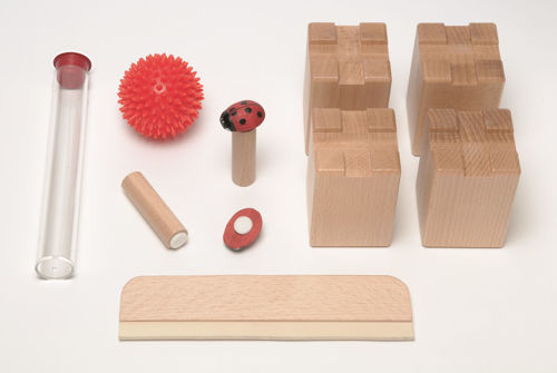 Sand Accessory Set for Standard Sand Tray, made from natural beech wood, includes 2 x sand pens 1 x tactile ball 2 x magnetic beetle game 1 x sand squeegee 4 x riser feet