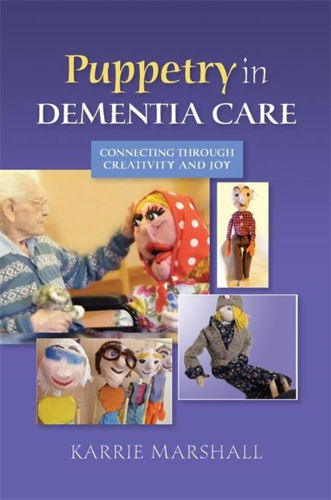 Puppetry in Dementia Care book, author Karrie Marshall, care home resource, softback book blue cover with images of hand made puppets with elderly man, 264 pages, size: (l) 22.8cm x (w) 15.4cm