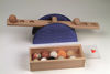 Material Balancing Game, natural wood and painted blue base  see saw balance to match with assorted weight balls,Set includes:  1 ball each of styrofoam, wax, stone, rubber, cork, paper, beech wood, linden wood, wool pom pom, felt and porcelain wooden storage box instructions Size: balance: (l) 50cm x (h) 12cm, balls: (dia_ 4cm, box: (l) 27cm x (w) 10.5cm x (d) 5.5cm.