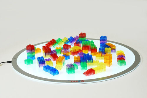 Translucent Colour Module Blocks, 90 assorted building blocks coloured acrylic, assorted sizes including square oblong rounded ends in blue red green yellow purple and orange, Size of largest brick: (l) 6.4cm x (w)3.2cm x (d)2.4cm.