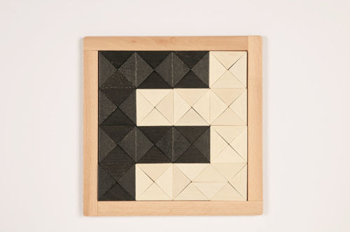 Magic Mosaic Activity, chunky wooden shapes for matching and arranging, Set includes:  32 black triangles 32 white triangles template sheets laying frame Size: triangles (l) 5cm x (d) 0.8cm. Frame (l) 24cm x (w) 24cm.