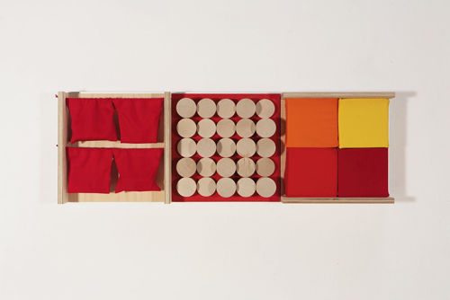 Sensory Wall Panel Set - Touch 1, wooden frame with four red empty elasticated bags for your own sensory items, four different coloured foam pads (1 each orange, red, yellow and maroon) and 25 birch wood cylinders needing different pressure to push and twist, Made from birch plywood with an aluminium frame. Bags from man made fabric.  Size: (l) 91cm x (w) 31cm.