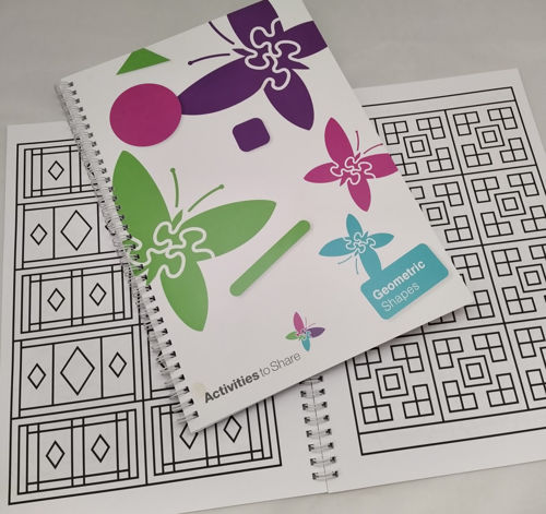 Large Print Geometric Colouring Book, spiral-bound softback book with assorted patterns to colour.  Book cover white background with purple pink blue and green butterfly shapes, 2 designs in background, size A4