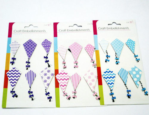 Kite Embellishments, set of 6 assorted kite shapes with tail and bows, diamond shape with self-adhesive back. Image shows 3 x packs with purple, pink and blue kite packs mounted on white card.