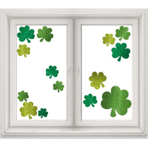 Shamrock Window Decorations, vinyl cling on decorations, pack of 14 assorted green and gold shamrocks, image shows shamrocks displayed on a window, Size: 46cm x 30cm sheet of stickers.