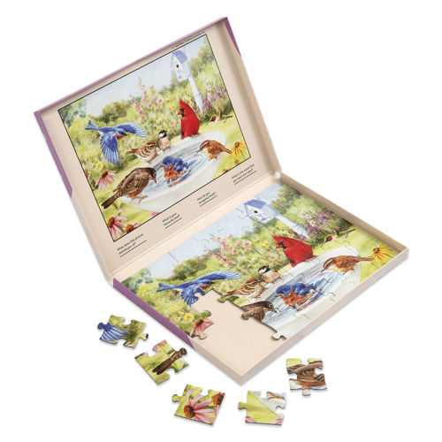 35 Large Piece Jigsaw Puzzle - Bathing Birds, chunky board pieces that are easy to grip, image shows open storage box with part completed puzzle, colourful birds splashing around in a birdbath with garden and house in the background, completed picture is on the box lid, Completed picture is incorporated into the box lid - makes it easy to follow.  Size: Box: (w) 31cm x (h) 22cm x (d) 2cm.
