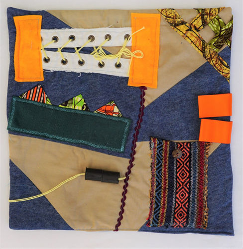 Fidget Activity Mat - African Print, larger mat featuring assorted attachments for anyone with dementia, Mat features:  multicoloured textured fabrics lacing panel lift up flaps ribbon loops threading tube Hand wash or machine on gently cycle.  Size: (40cm x 39cm).